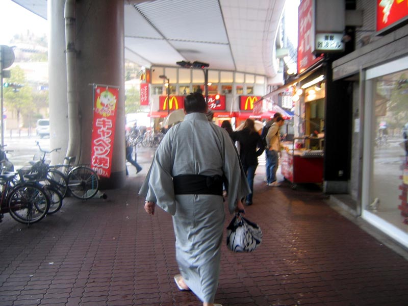 A sumo wrestler on the way to his match
