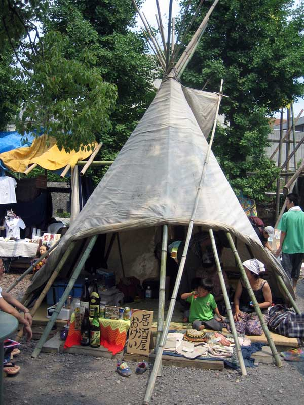 "The sign reads ""Izakaya.""  An Izakaya is a Japanese-style bar.  This is a teepee.  That's funny."