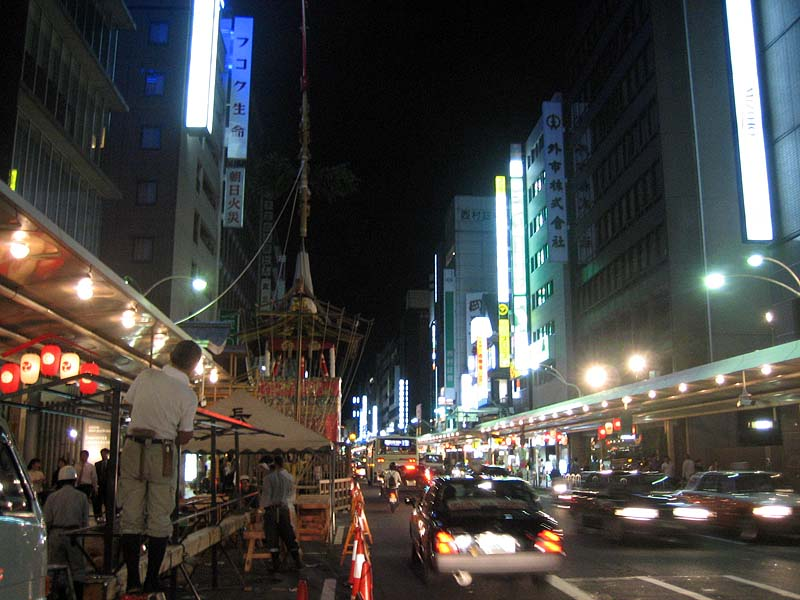 "This is the very end (the ""outskirts"" if you will) of the famous Shijo Dori in Downtown, Kyoto.  Look at the freakin' height of that mikoshi!"