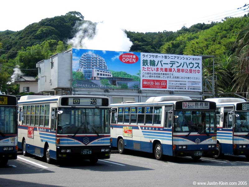 Steam rising up from behind a bus terminal, Beppu