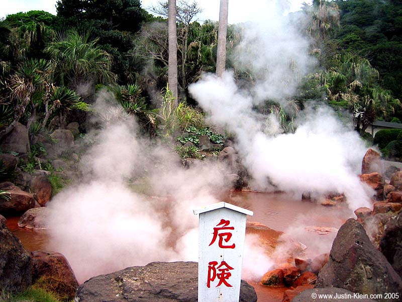 "Another steaming natural spring in Beppu.  The sign in the foreground says ""Danger."""
