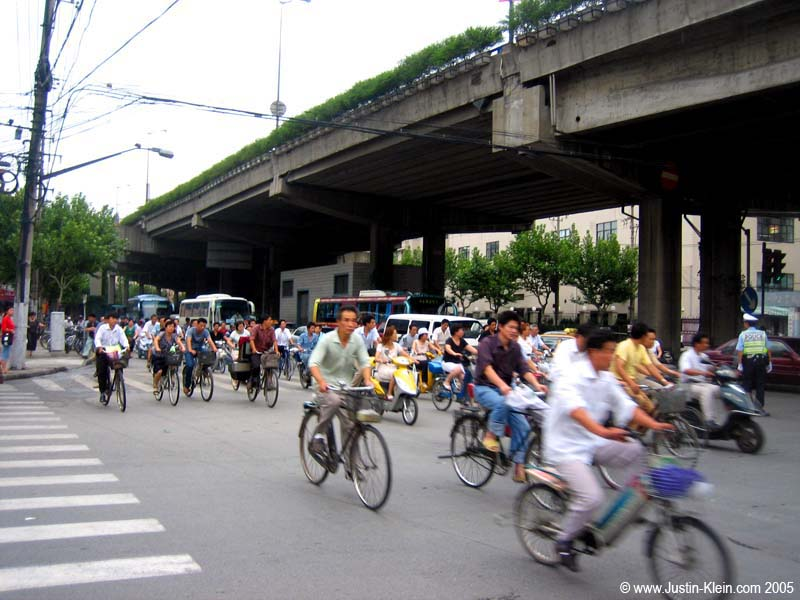 Swarms of bikes zoom through intersections in every direction regardless of the state of the traffic lights.  Horns are ALWAYS blaring.