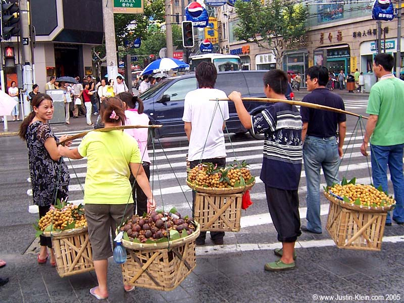 Fruit sellers walking the streets of Shanghai.