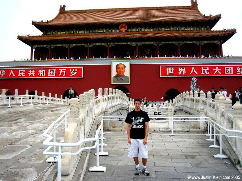 "Me at Tiananmen Square, the center of the Communist world.  I'm wearing my only remaining clean T-shirt: ""I Climbed the Great Wall.""  Can you tell that I'm a tourist?"
