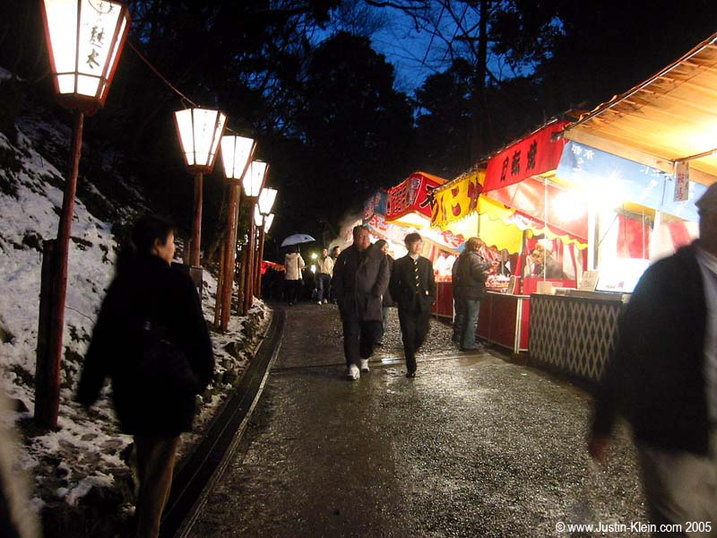 A row of food booths at a festival last winter in Kyoto, not dissimilar (at a glance) to the night market in Beijing.