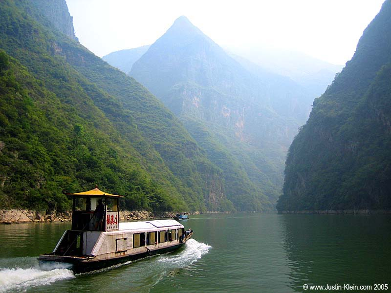 "Some local transportation passing through one of the ""Lesser Three Gorges."""