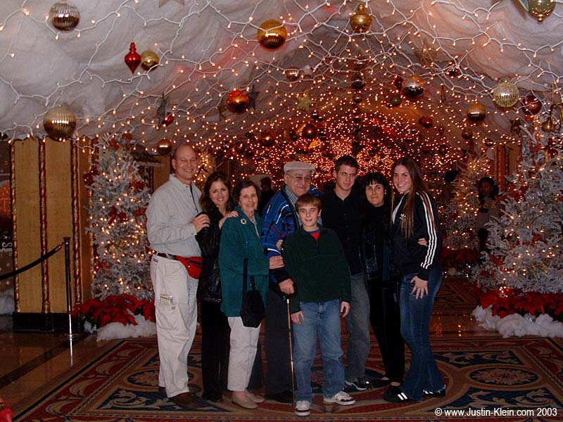 My mom's side of the family in New Orleans for Christmas 2003.  To the far left is Dan, the birthday boy, sporting his ceremonial red fanny-pack.