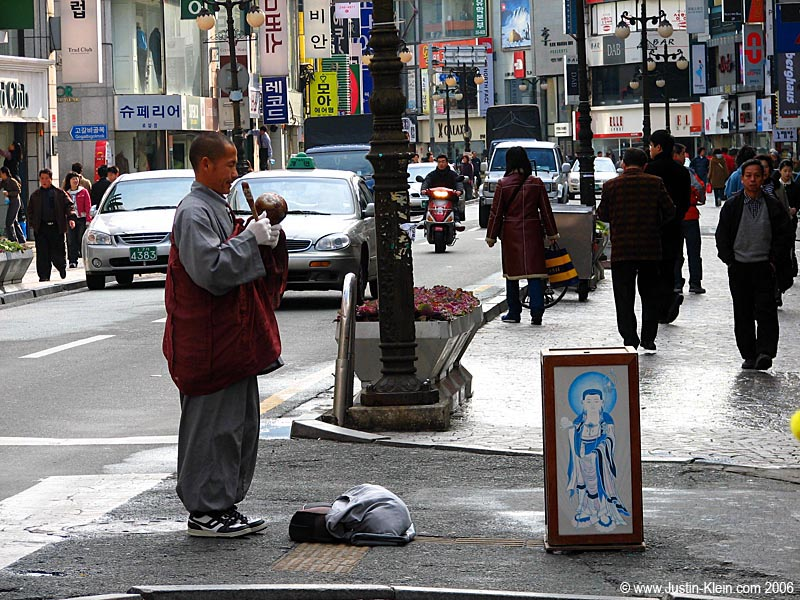 A monk begging for money.