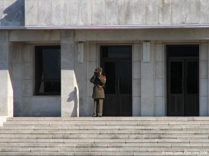 Looks like the observation towers aren't quite as distant as I thought.  A real-life North Korean communist soldier.  Within eyesight and earshot.