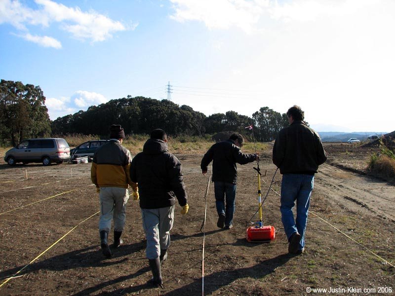 Dean, Higashi-san, and the two helpers from City Hall dragging their fancy radar equipment over some suspected burial chambers in Miyazaki Prefecture.