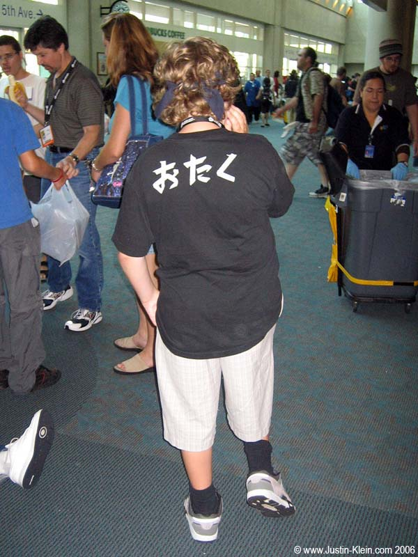 Nah, Comicon isn&#8217;t for nerds or anything. (For the Japanese-impaired, this young man has written on his shirt a word meaning &#8220;snot-nosed socially inept anime/comic-book nerd.&#8221;  On his <i>own</i> shirt.)