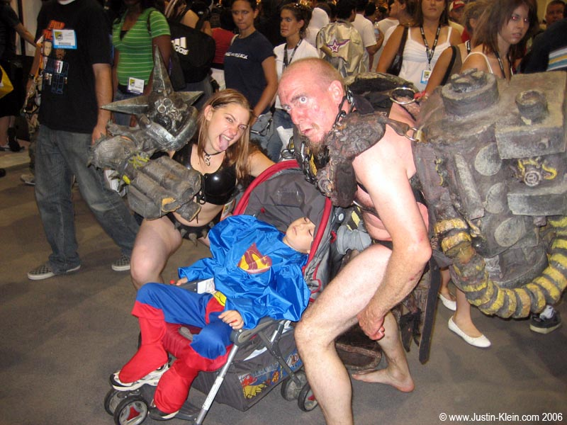 A cosplay family.  I'm not sure what the parents were supposed to be, but I predict that this child might just have some issues to resolve when he gets older.  Like, why his father chose to roam about in public wearing a G-string with a styrofoam bolt covering his privatest of privates.
