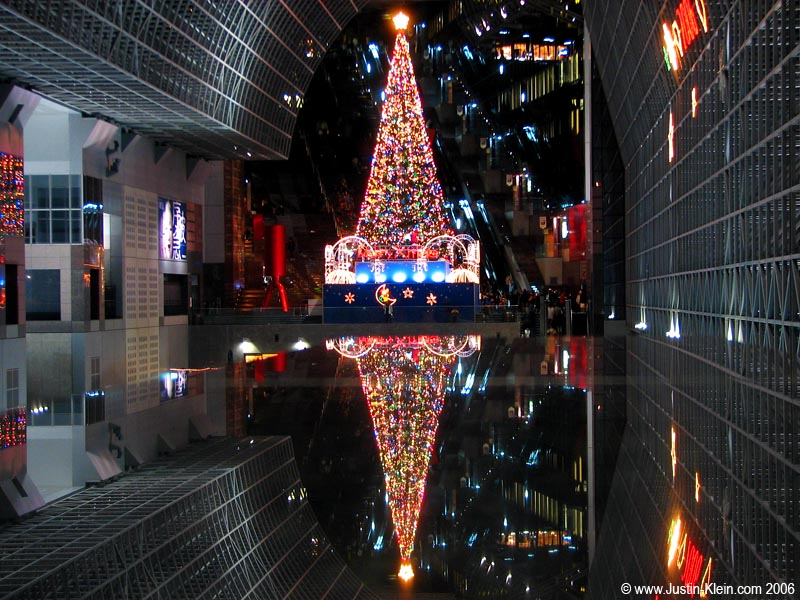 Although Japan is only 0.7% Christian, they absolutely love Christmas – and the city is decorated accordingly.  Virtually every building puts up elaborate lighting displays, covered shopping arcades play Christmas carols, and Kyoto Station erects this enormous tree which thousands of people flock to photograph every year. Um…including me.