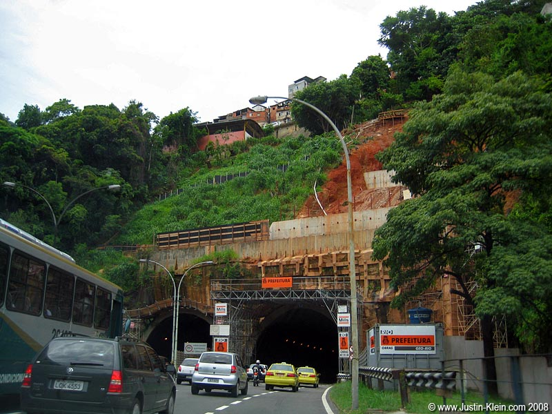 Out for a drive – those little buildings above the tunnel are the very bottom of one of Rio's hilltop favelas.