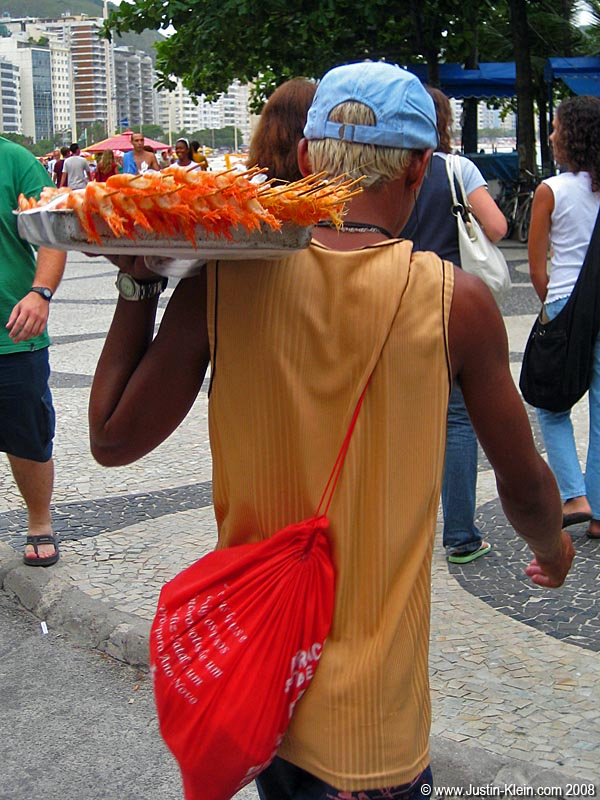An interesting-looking guy heading to the sands of Ipanema for a bit of shrimp-selling.