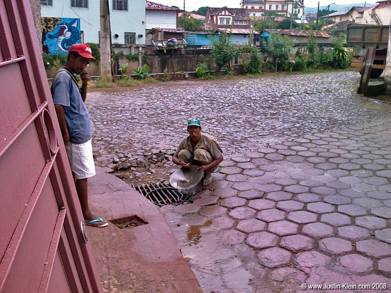 Some locals rinsing out their pan to see if any gold got left behind.