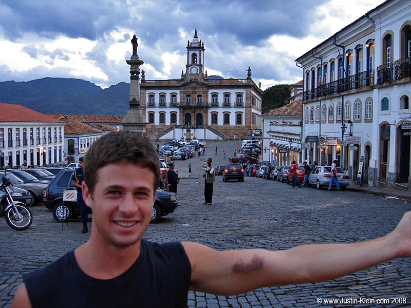 "Showing off my bruised arm in town square, Ouro Preto. (See the post ""Two More Nights in Araial"")"