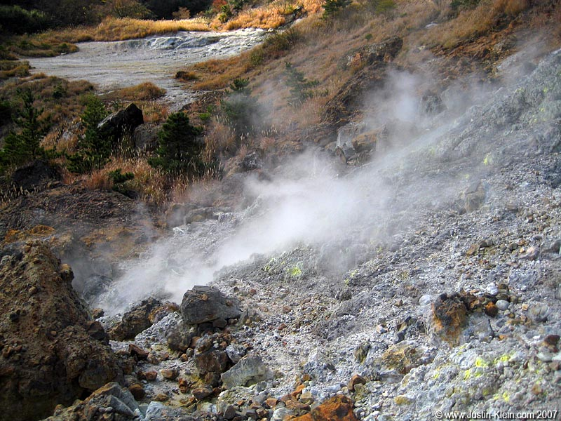 A steaming mountainside.