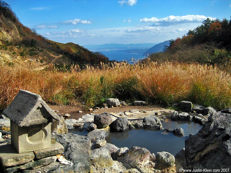 A <i>more</i> secluded bath, with Beppu visible in the distance.