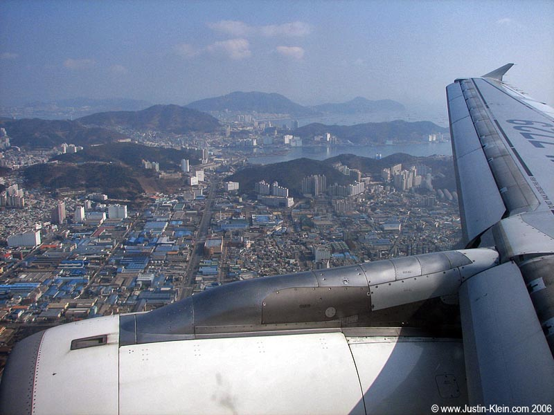 This photo is a LIE.  It was taken over Busan, South Korea one year earlier.  It was just the first airline photo I found while working on this post : P