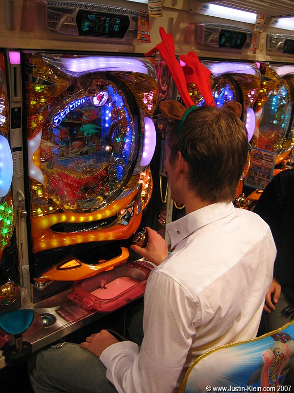 Peder trying his hand at Pachinko, one of the most prevalent Japanese activities which I&#8217;d <i>never</i> tried until this day.