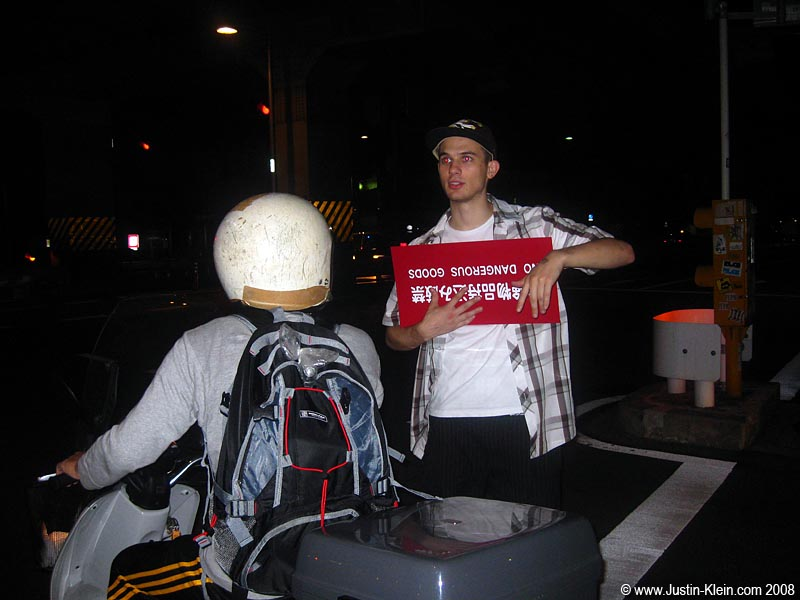 This is not HousePartyGuy.  This is just a very drunk, but very amusing foreigner we met while walking from Shibuya to Roppongi on Friday night.  He decided to join up with our group on its quest for fun. …And to protect us from Dangerous Goods.