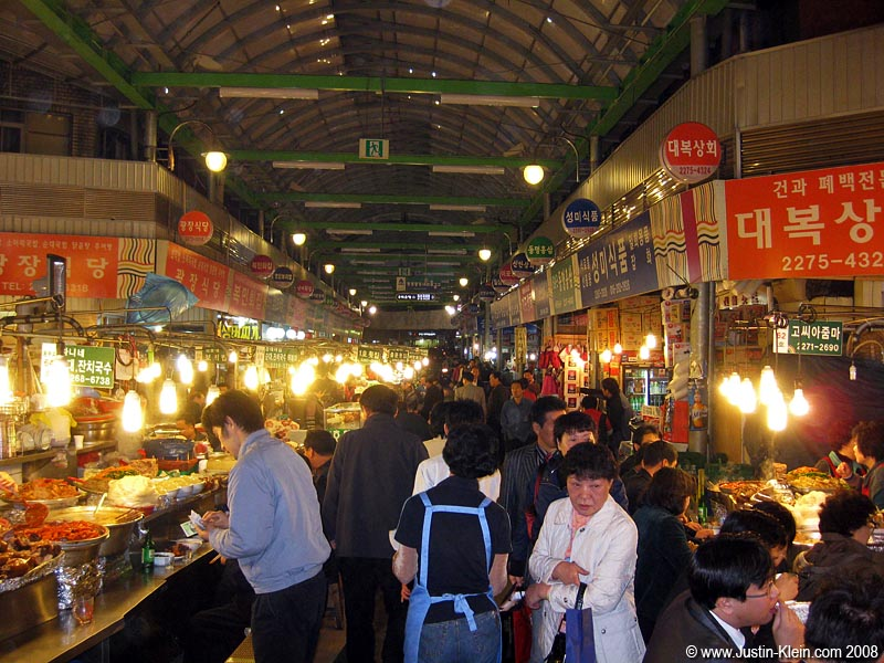 A covered shopping arcade, so crammed with food vendors you can scarcely manage to move.