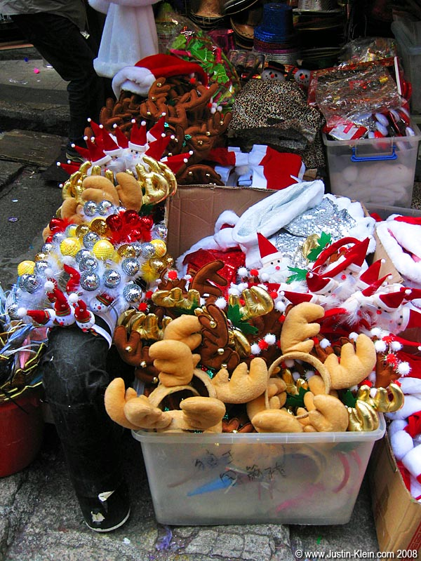 Remember how I said Hong Kongers bling up like crazy when they go out at night?  I actually found an entire street selling <i>only</i> Santa outfits, reindeer antlers, Christmas tree ornaments, and other holiday-related paraphernalia.