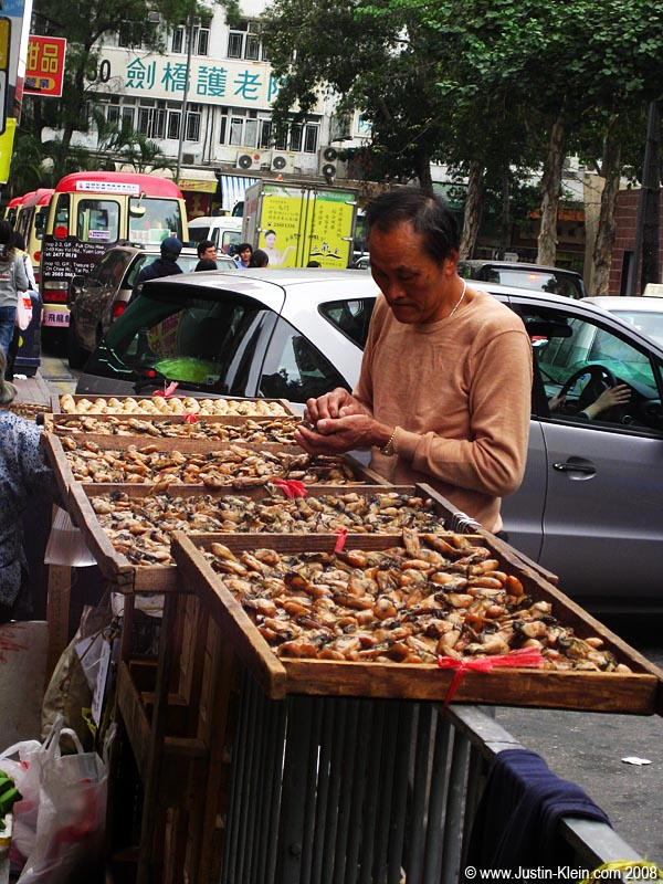 Selling dried mussels.