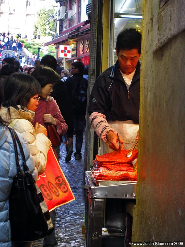 Selling thin cuts of beef in a very Chinese-feeling street market.