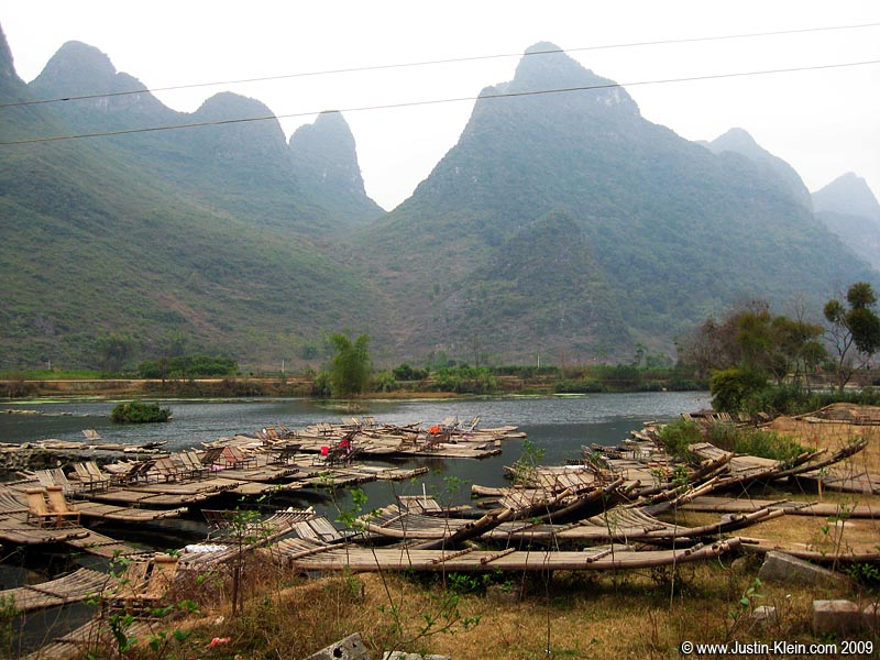 I mentioned in the previous post how many of Yangshuo's summer activities are unavailable in the winter. Here we find an army of bamboo rafts…eagerly awaiting next year's peak tourist crowd.