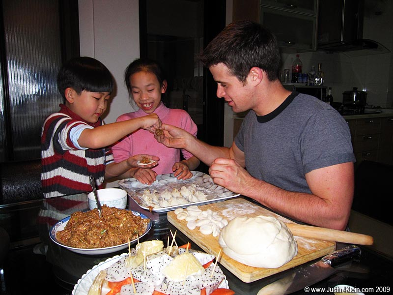 Making jiaozi with Junior and his cousin.