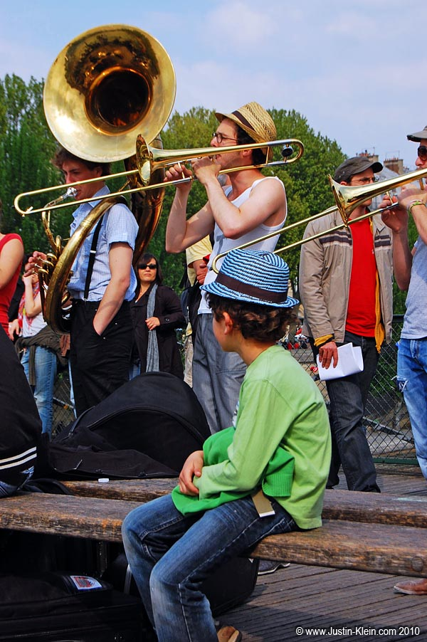 A boy watching some street performers at Ponte des Artes, Paris.