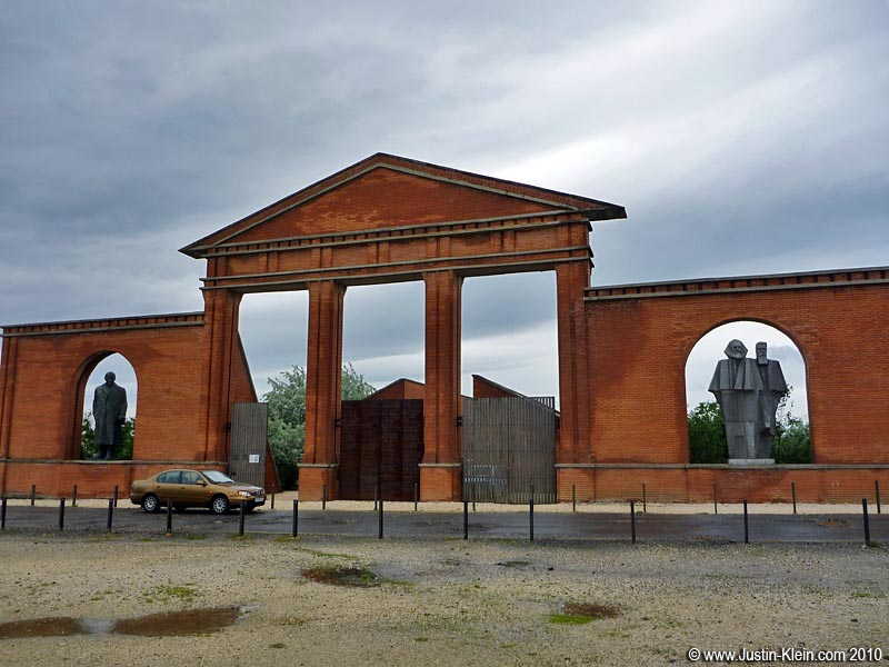 The entrance to Memento Park.  The statues to the right are Marx and Engels; to the left is Lenin.