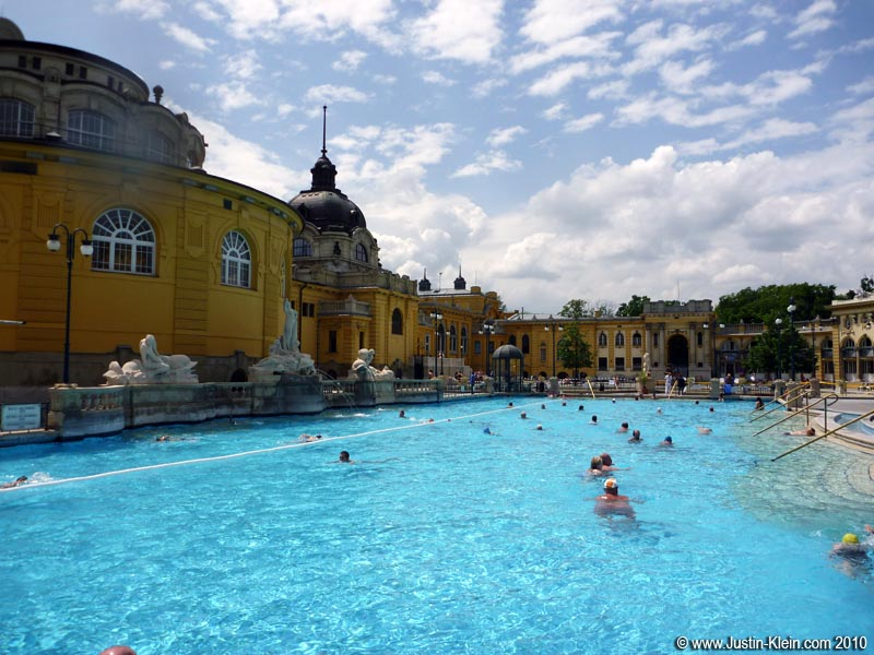 "One of the outdoor pools at the Széchenyi Baths.  Unfortunately I didn't get any photos of the ""fun area"" described below, because those were hot-water tubs and I was reluctant to bring my underwater camera for fear of the heat affecting the seals."