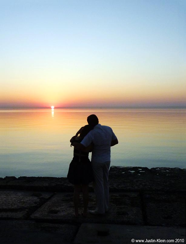 Two new friends watch the sunrise over the Black Sea.