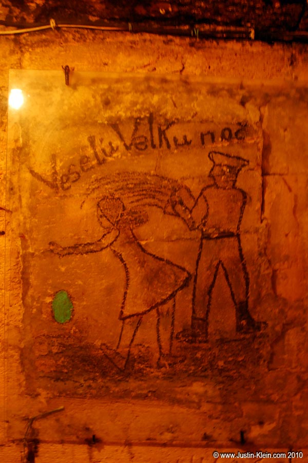 A peculiar wall drawing in the Odesa catacombs.  Anyone care to translate?