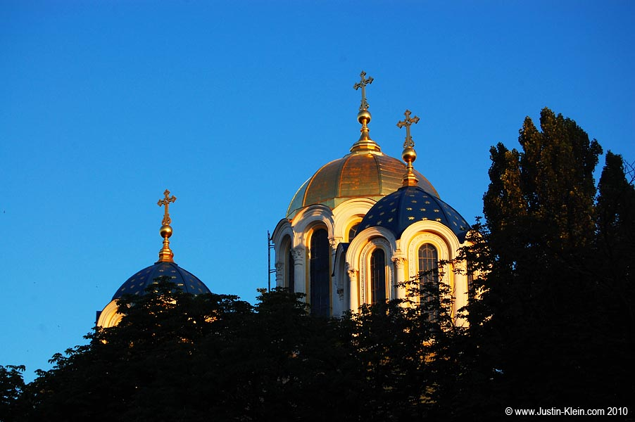 St. Volodymyr's Cathedral peeks out at the setting sun.