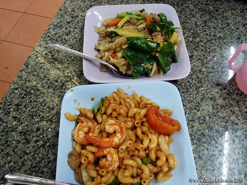 Chicken with broad noodles and some kind of shrimp macaroni.