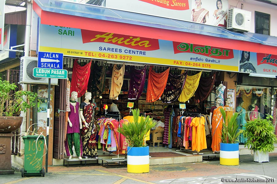 Rainbow-colored saris for sale.