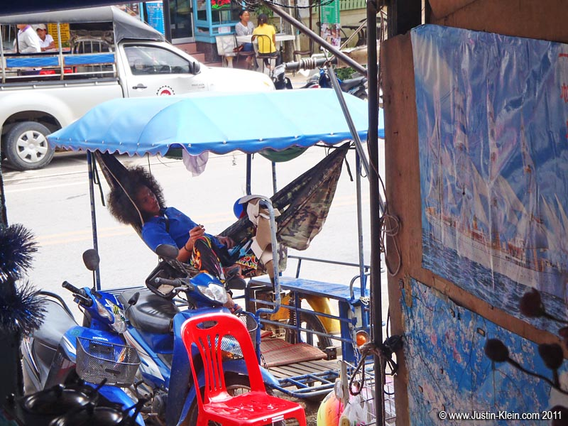 "As soon as I wrote the words ""slow down and move leisurely,"" I thought of this guy: a lazy tuktuk driver in Ao Nang.  Every day he'd park in front of my favorite little restaurant and pass out in his hammock."
