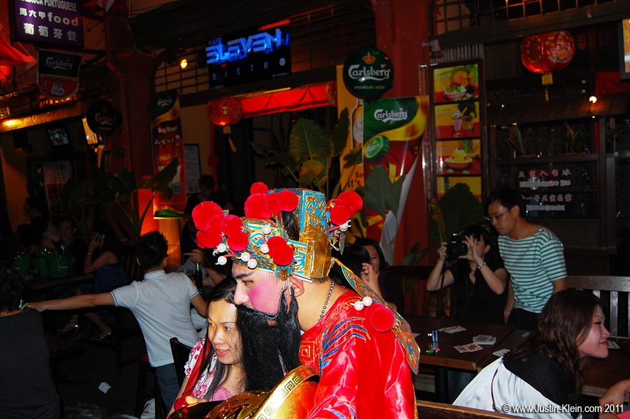 The bar street near Jonker was overflowing with people – some chugging beer-towers at outdoor tables, some playing with party poppers, some just roaming about in costume.