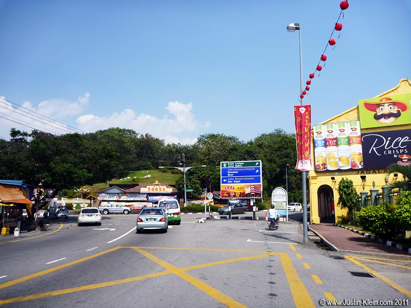 Heading towards Bukit China.  Don't ask me what Mario's doing on that billboard : P