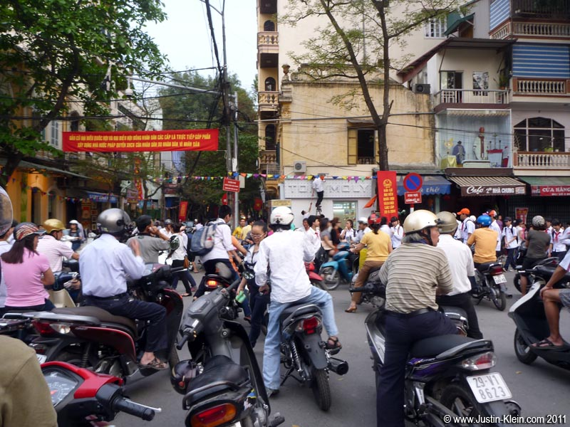 Traffic in Hanoi is beyond insane: a chaotic jumble of motorbikes, cars, and pedestrians going every which way.