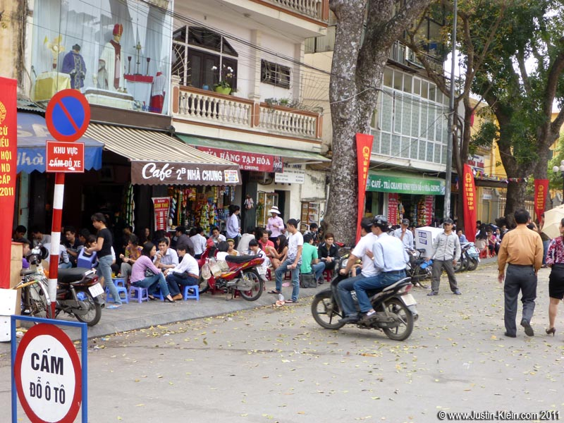 Everywhere you go in Hanoi, hundreds of people seem to be sitting around just doing nothing in particular.