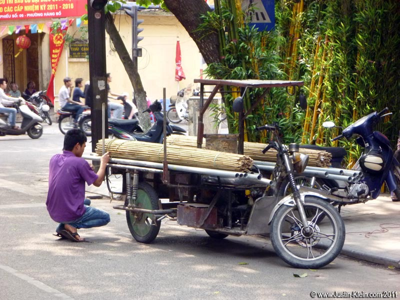 A bamboo delivery boy prepping his haul for the day.