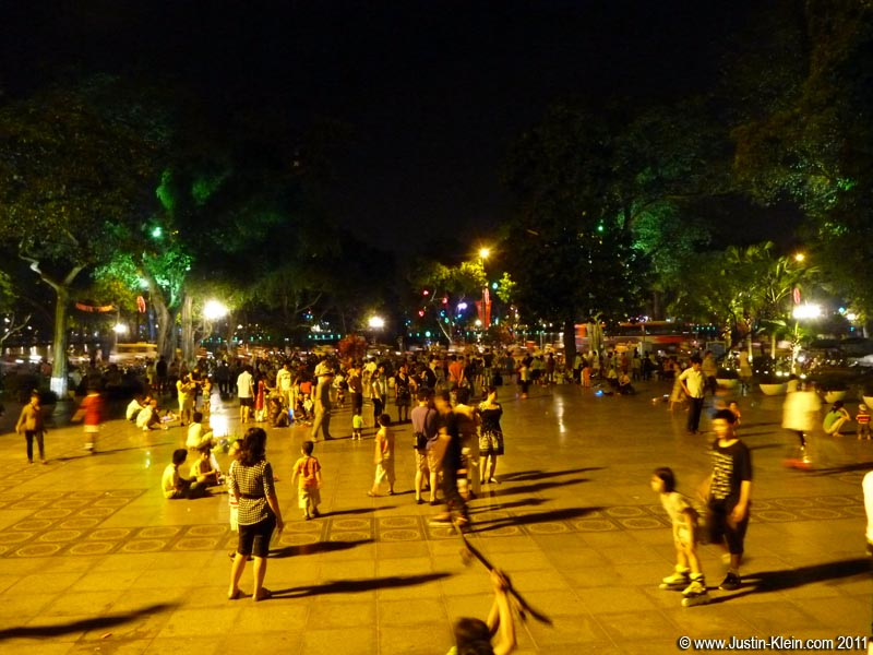 A bustling square next to Hoan Kiem Lake.