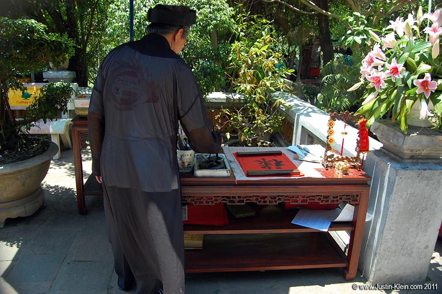 A calligrapher at Ngoc Son Temple.