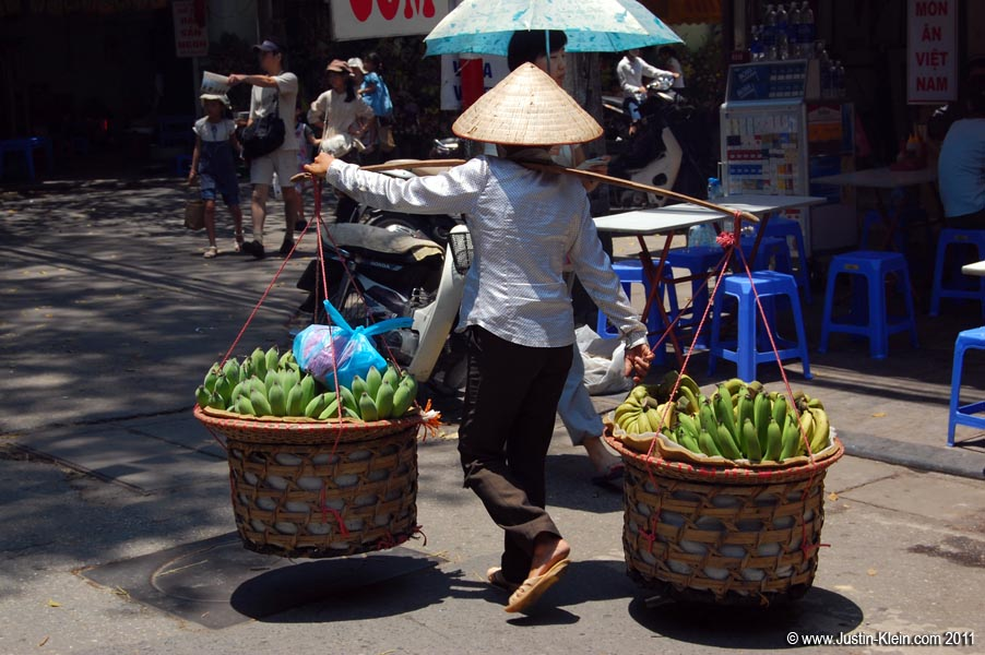 Vendors like these are <i>everywhere</i> in Hanoi.  They usually know exactly two words of English: the name of whatever they&#8217;re selling, and &#8220;Photo?&#8221; (uttered just before they try to put their baskets over your neck.)