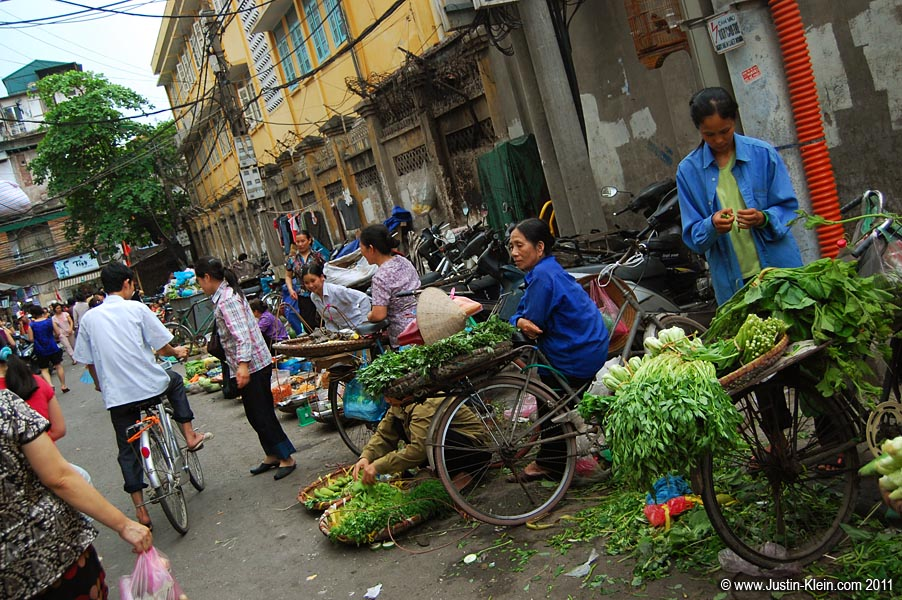 The narrow Pho Thanh Ha, with its traditional street market of squirming fish, croaking frogs and heaped produce.